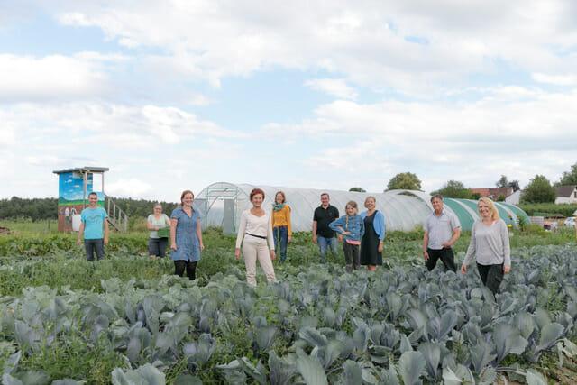 Team of harvesters on a farm (SoLaWi)